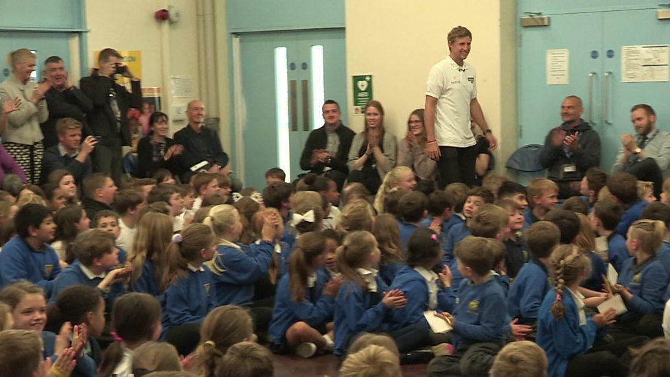 Joe Root surprises kids at old school