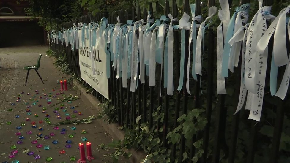People gather together at peace vigil