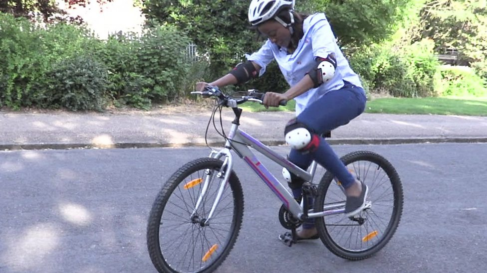 Whitney learns to cycle!