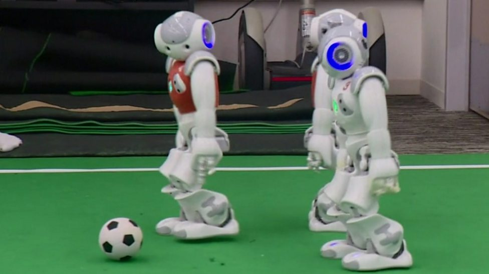 Football playing robots who learn as they play