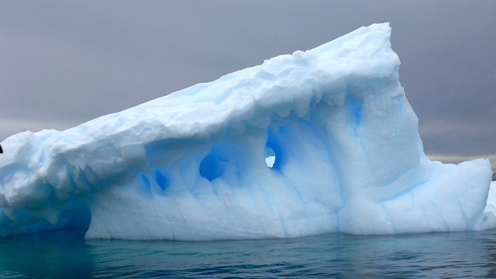 How far under water do icebergs go?
