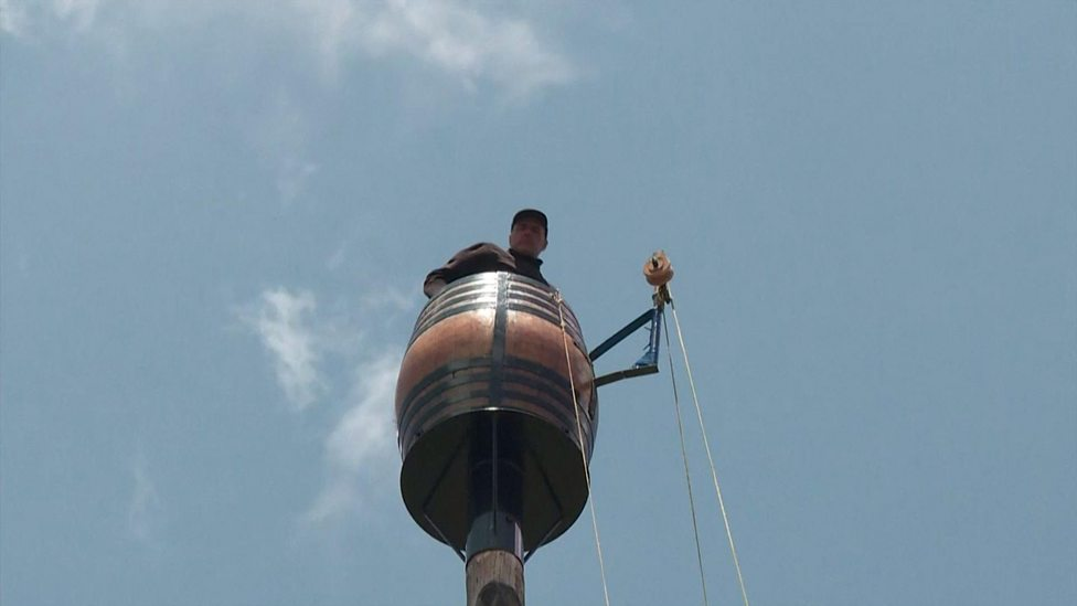 This man is living in a barrel in the sky! Er, what?