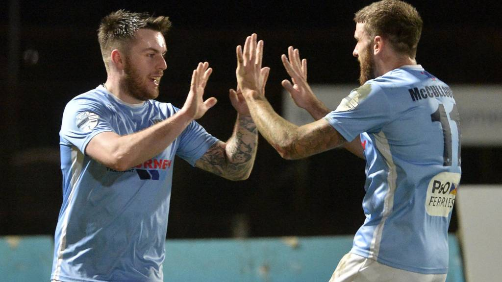 Ballymena players celebrate Cathair Friel's goal