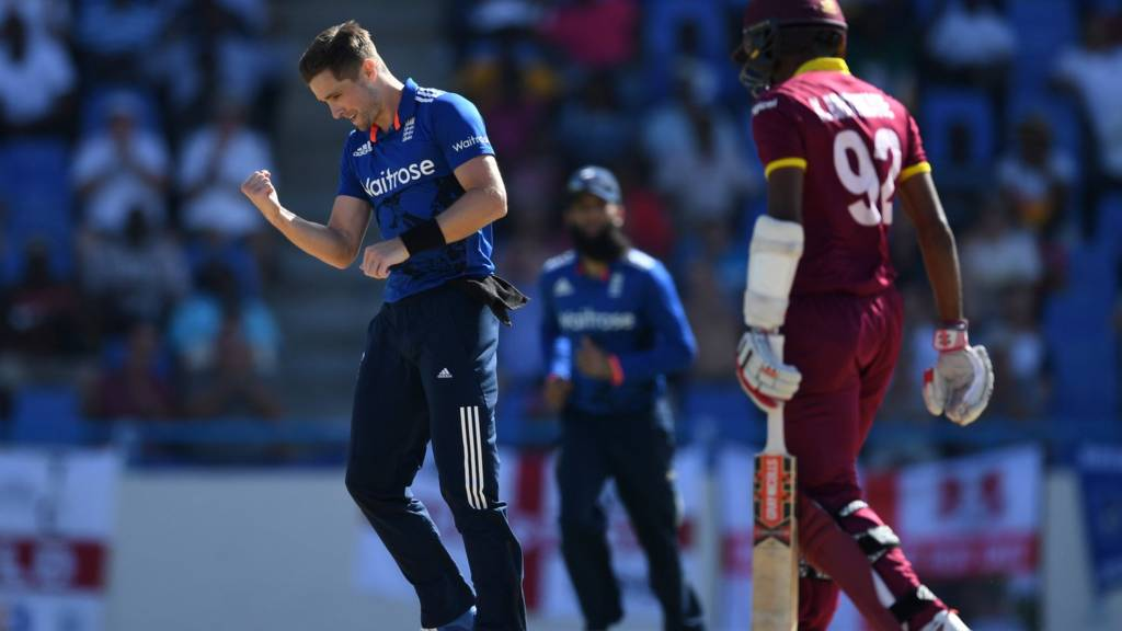 Chris Woakes of England celebrates dismissing Kraigg Brathwaite of