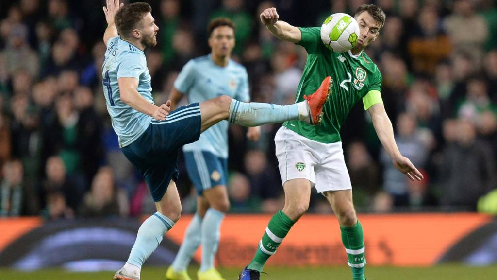 Northern Ireland's Stuart Dallas competes against Seamus Coleman of the Republic of Ireland
