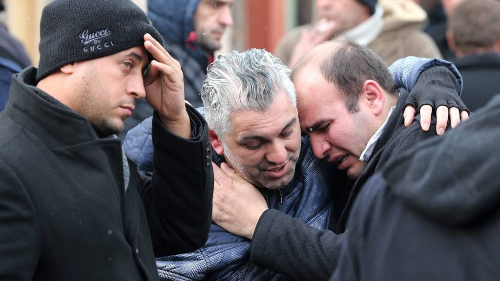elatives of victims mourn in front in front of the forensic medicine institute after a gun attack on Reina, a popular night club in Istanbul near by the Bosphorus, early morning in Istanbul, Turkey