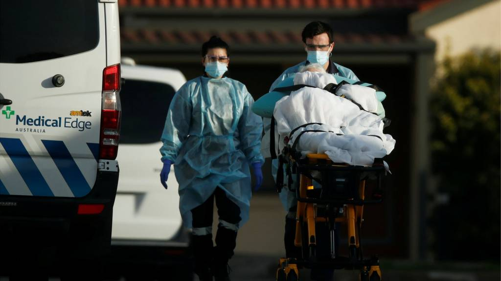 A patient is removed from an aged care facility experiencing an outbreak of the coronavirus disease (COVID-19) in Melbourne, Australia, July 31, 2020