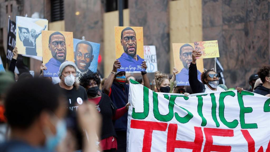 Protesters march on the first day of opening statements in the trial of former police officer Derek Chauvin, who is facing murder charges in the death of George Floyd, in Minneapolis, Minnesota, U.S., March 29, 2021