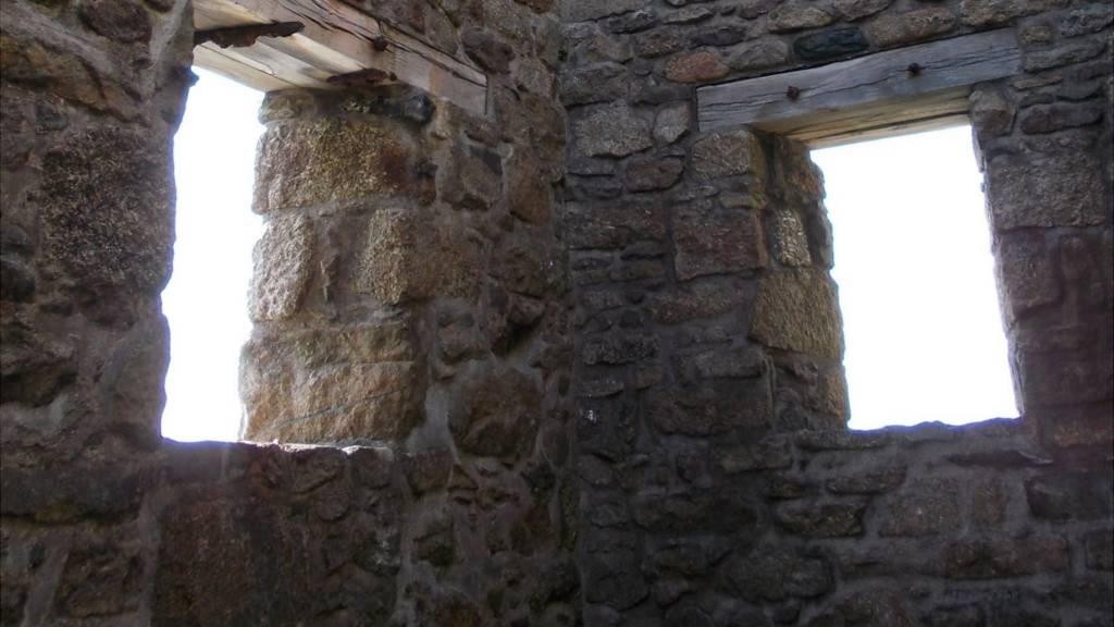 Windows in derelict building