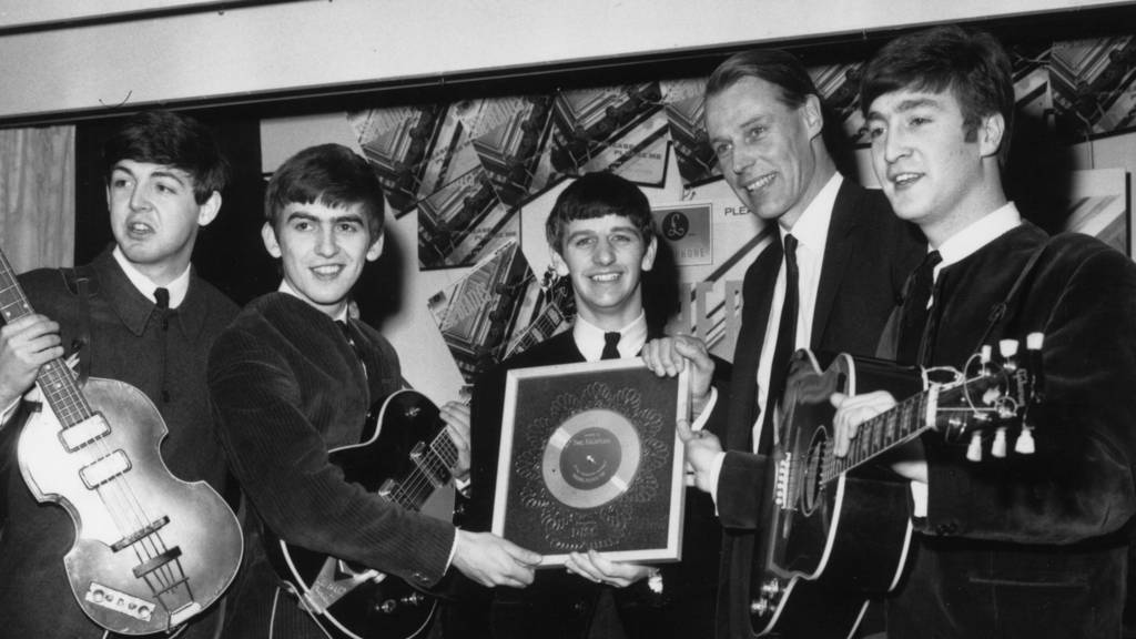 The Beatles with record producer George Martin