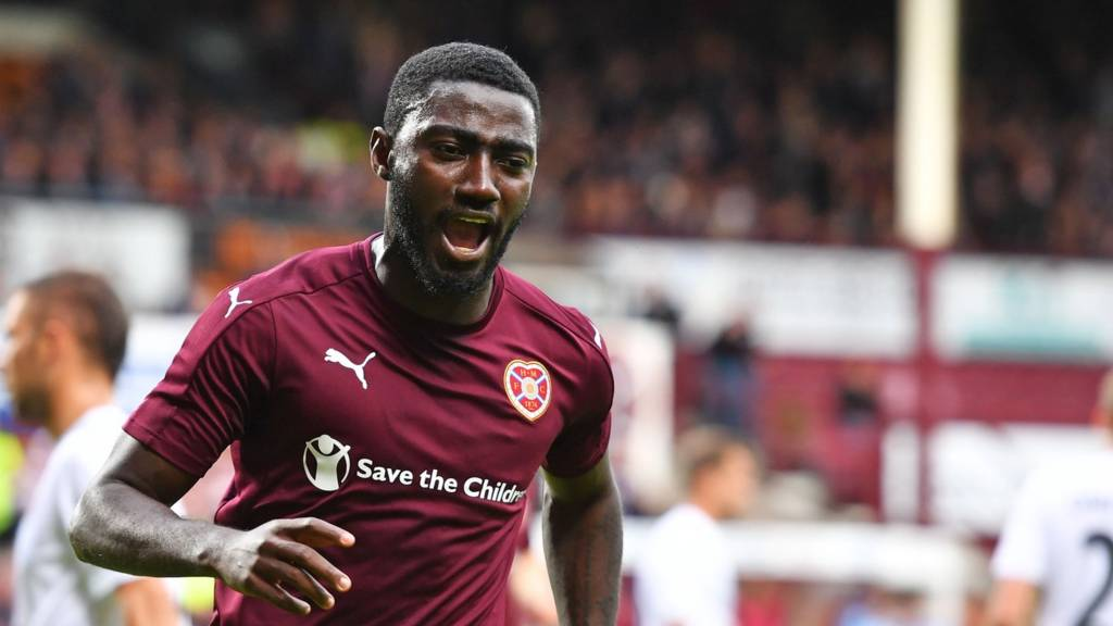 Prince Buaben celebrates his equalising penalty for Hearts