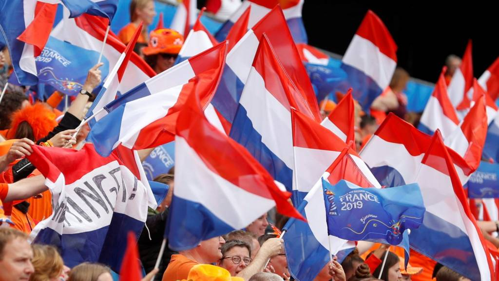 Netherlands' flags flown by their supporters