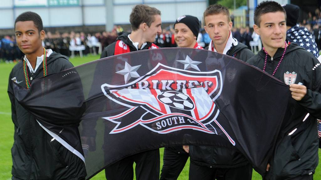 Members of the Strikers FC squad at the tournament's opening ceremony in 2015