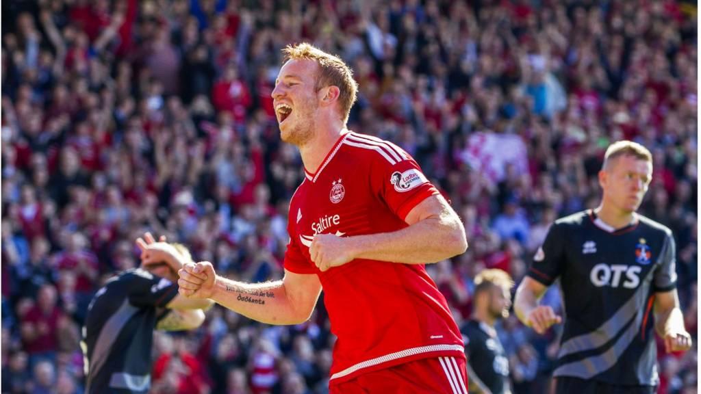 Adam Rooney celebrates