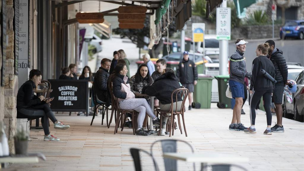 People outside a cafe in Bronte, Sydney, NSW, Australia