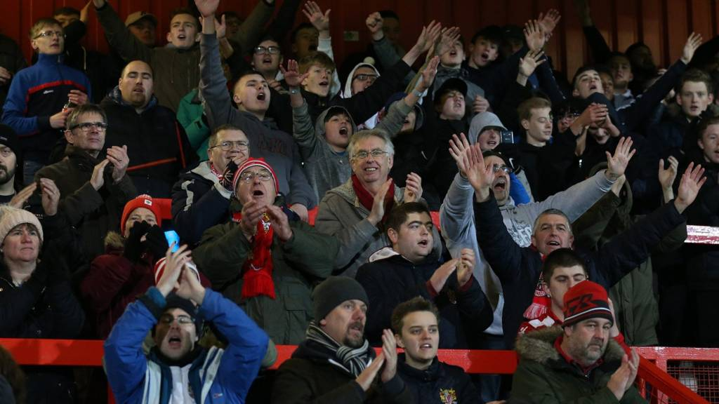 Exeter fans celebrate after their team scores in the FA Cup