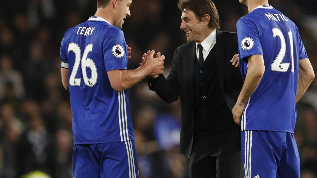 John Terry and Antonio Conte shake hands
