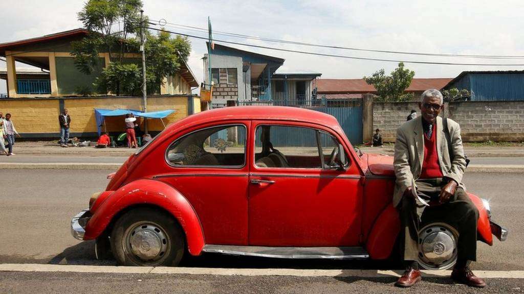 Siyum Haile, 72, a retired United Nations (UN) employee and Jehovah's Witness, poses for a photograph next to his 1977 model Volkswagen Beetle car in Addis Ababa, Ethiopia - 16 September 2017 - photo published 27 October 2017