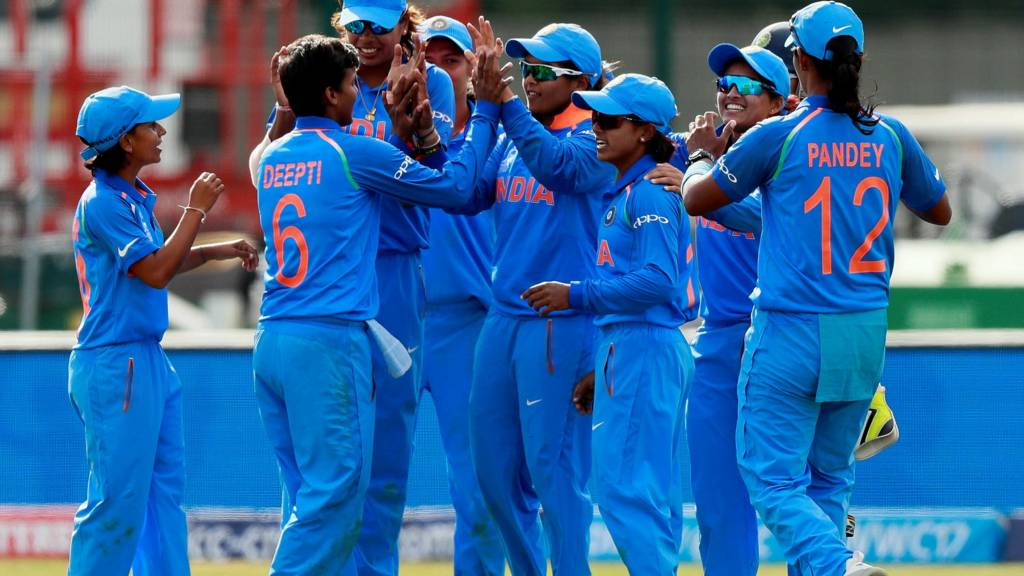 India celebrate beating England