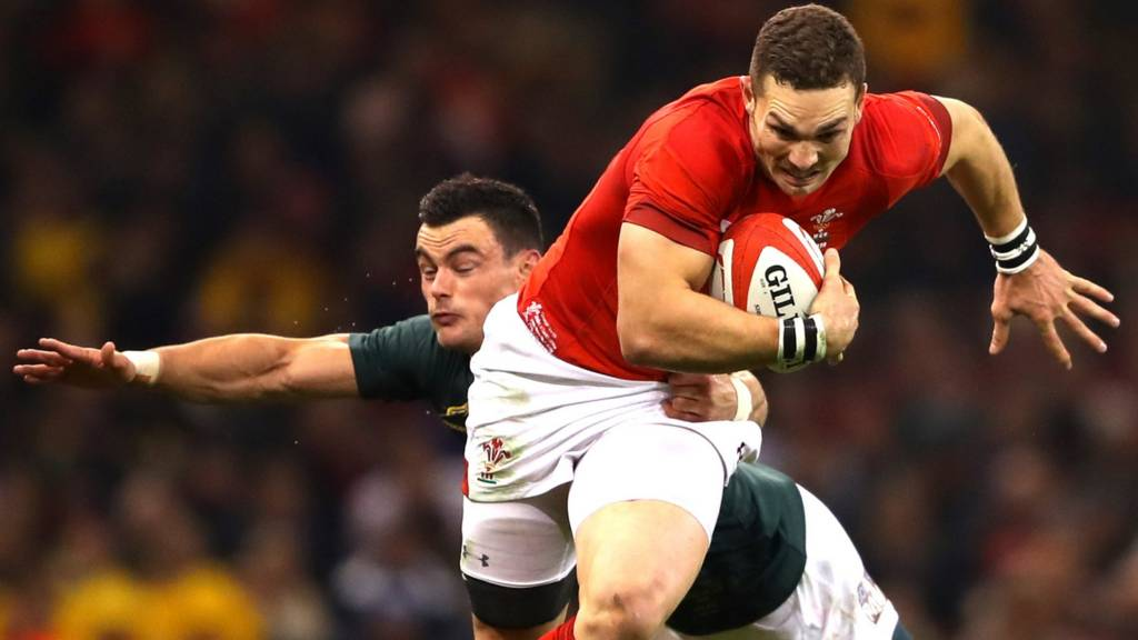 George North gets past a defender