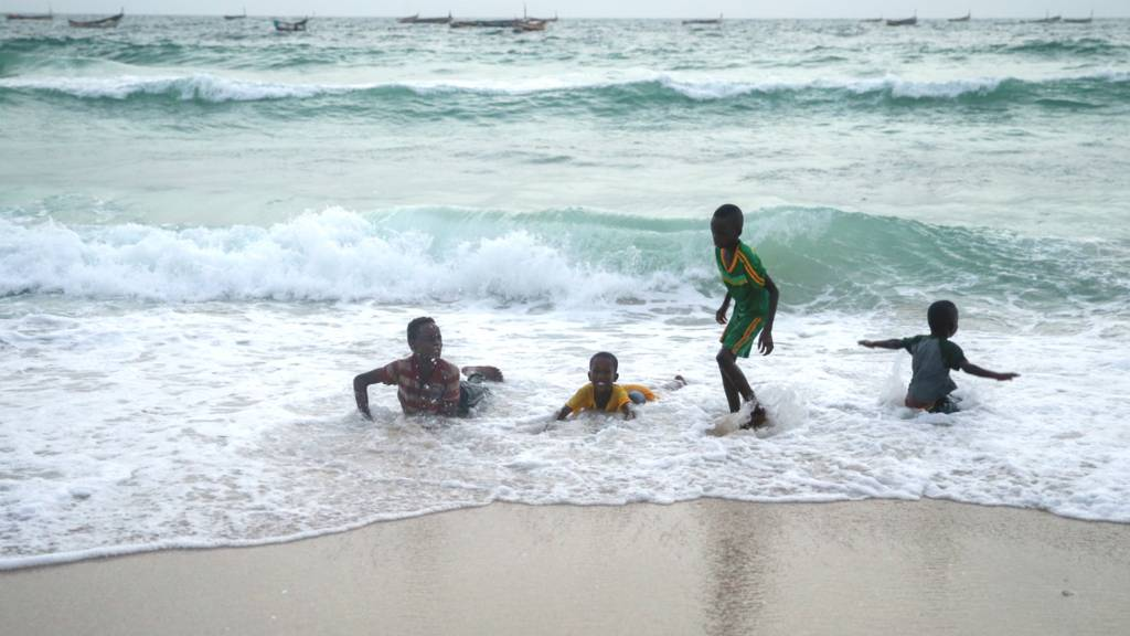 Children playing in the sea in Mauritania