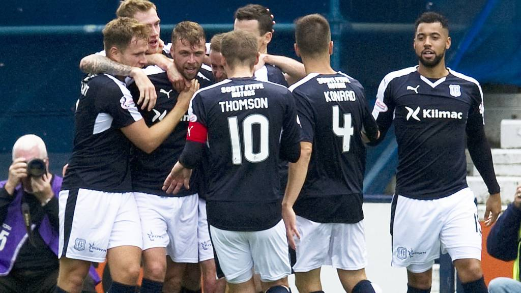Dundee players celebrate one of their three goals at Rugby Park
