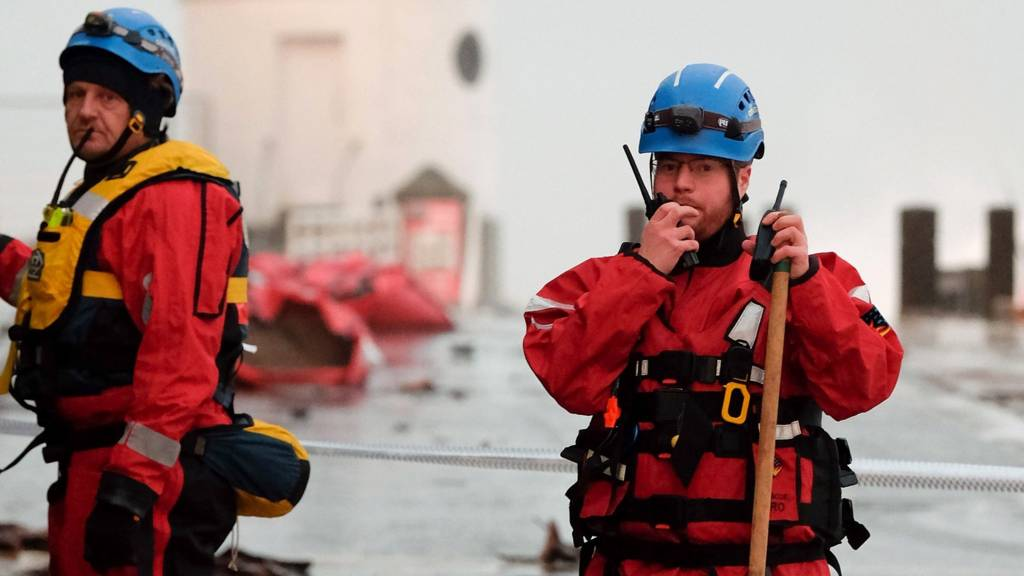 Members of the Coastguard Rescue helping with tidal surge aftermath