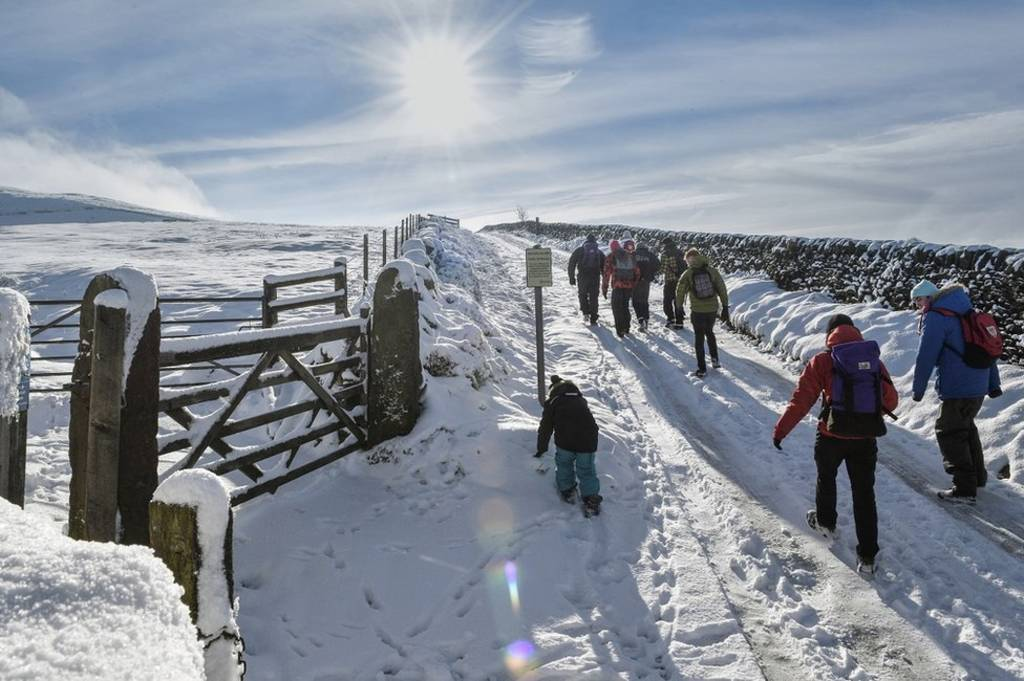 Walkers on a snow-covered path