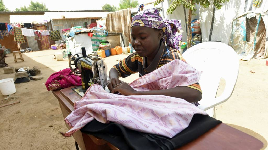 Woman using a sewing machine in northern Nigeria