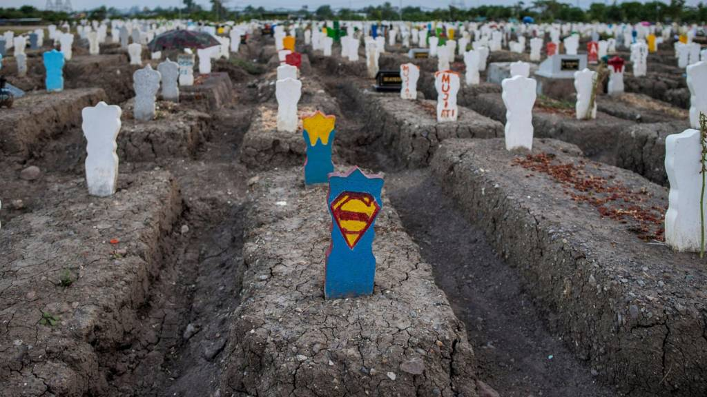 - A headstone with a Superman symbol is seen at a burial site for victims of the COVID-19 coronavirus at Keputih cemetery in Surabaya, East Java