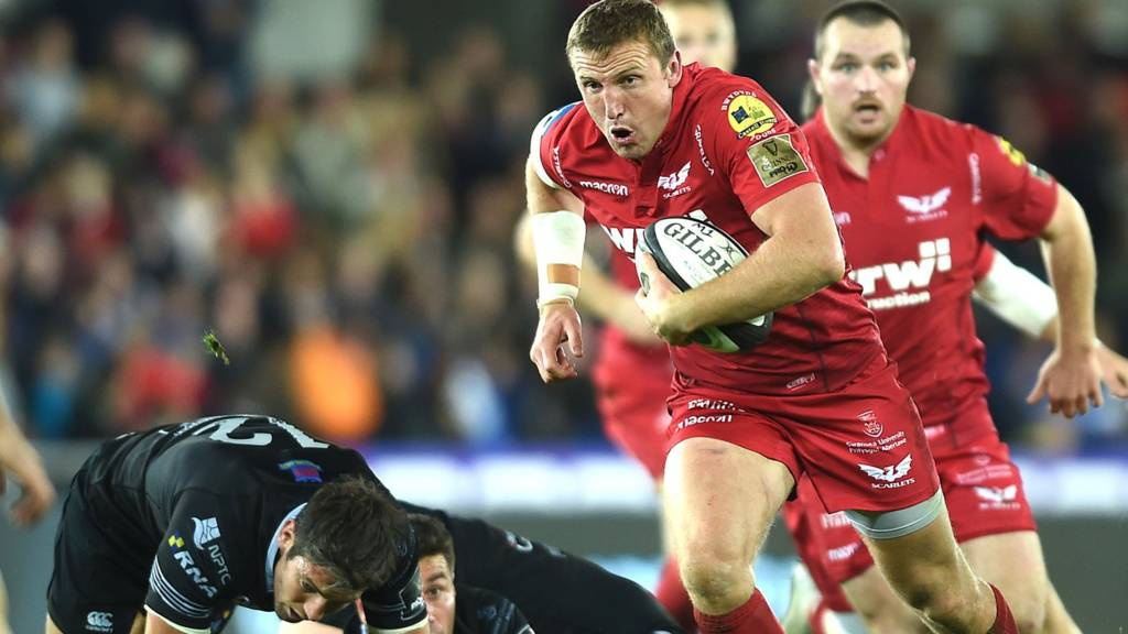 Hadleigh Parkes makes a break for Scarlets