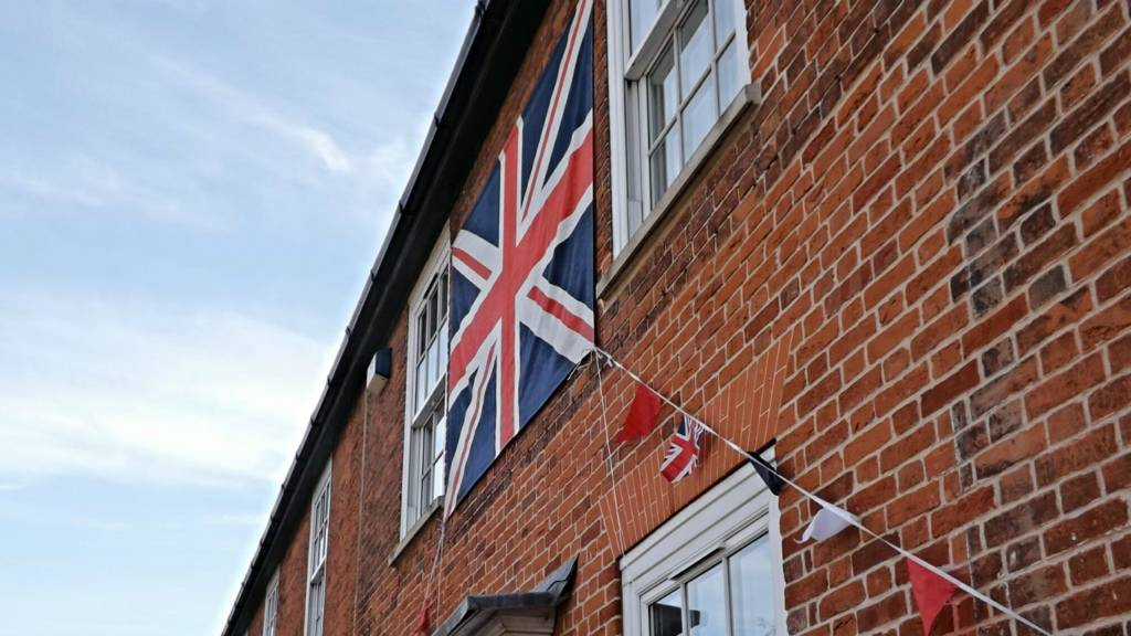 Bramford house with flags