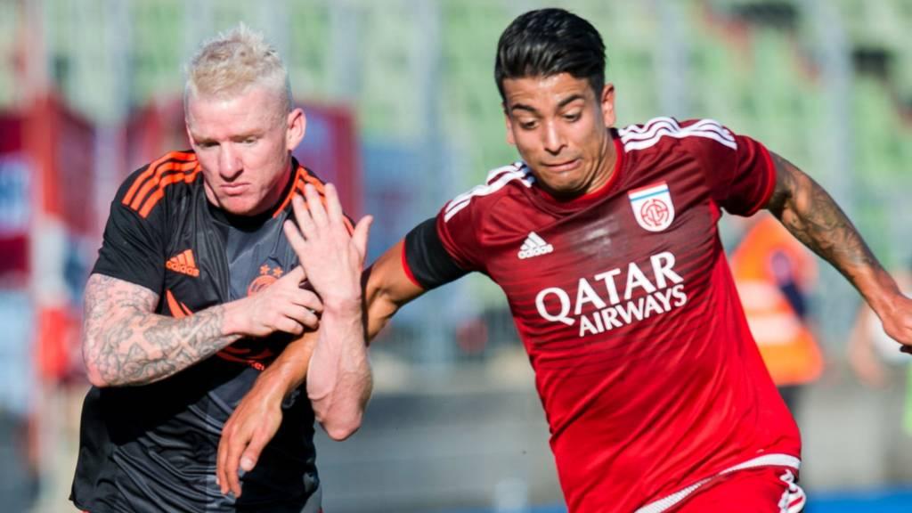 Aberdeen's Jonny Hayes (left) and Fola Esch's Kirch Mehdi