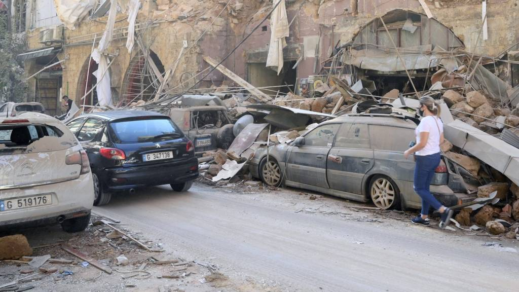 Vehicles damaged in the aftermath of a huge blast in Beirut