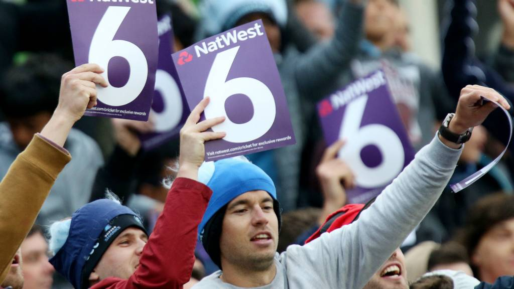Fans hold up 6 signs at a T20 Blast match