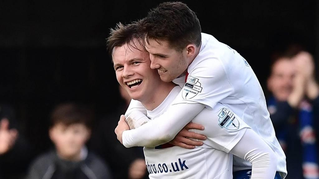 Linfield celebrate Niall Quinn's goal against Dungannon