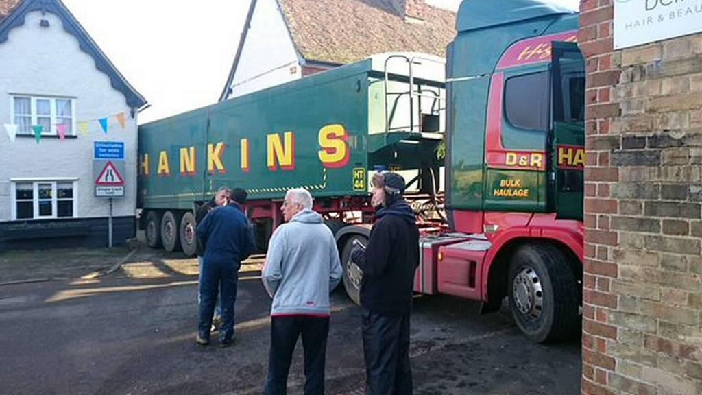 Lorry blocks road
