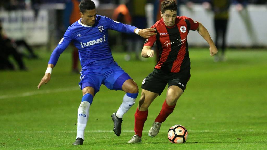 "Brackley Town""s Adam Walker (right) Gillingham""s Bradley Garmston battle for the ball during the FA Cup First Round Replay"