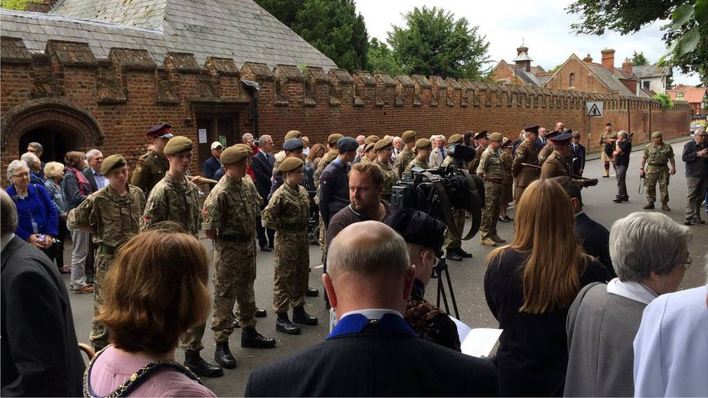 Crowds gather outside Buckden Towers to commemorate the Battle of the Somme