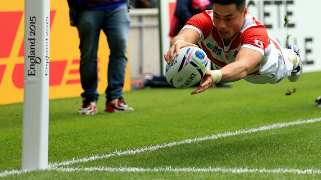 Japan's Akihito Yamada scores a try