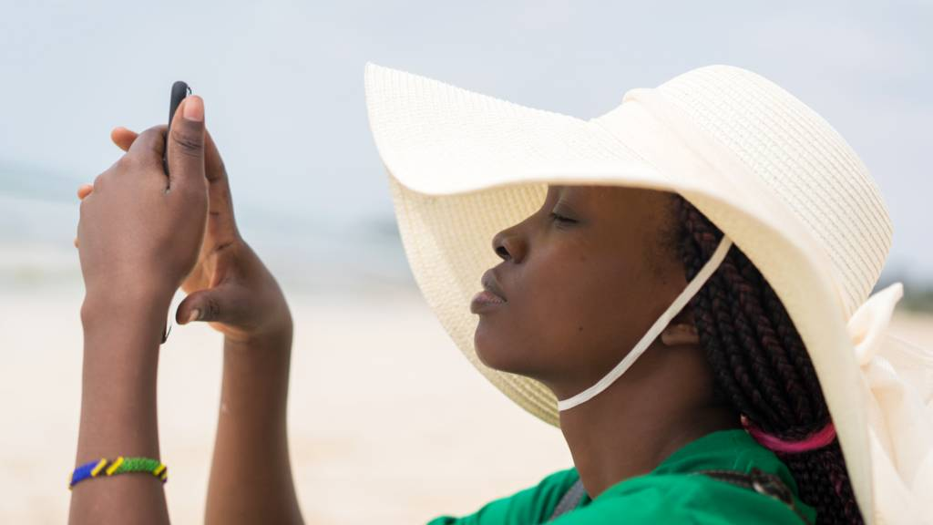 A woman checking her mobile phone in Tanzania