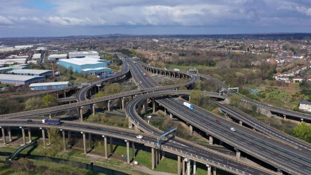 UK lockdown - Traffic moves through Gravelly Hill Interchange, junction 6 of the M6 motorway where it meets the A38 Aston Expressway