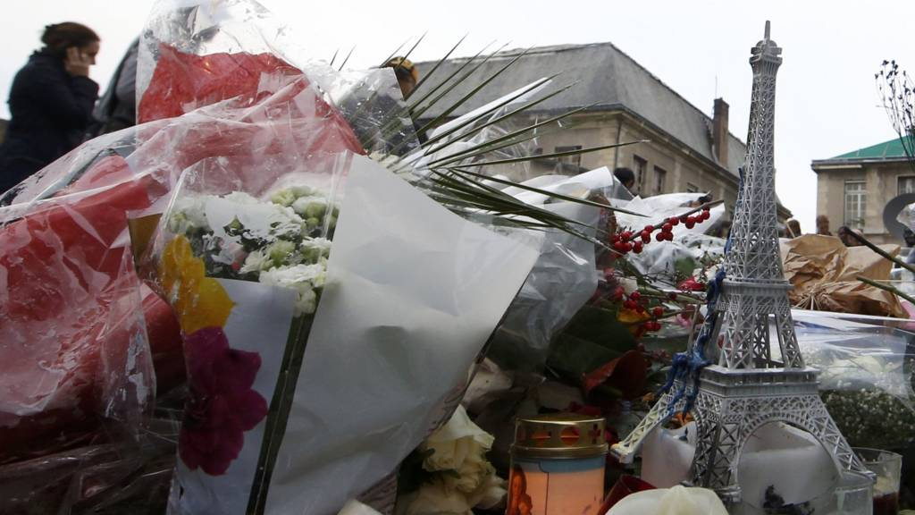 Flowers and candles left at one of the attack sites in Paris