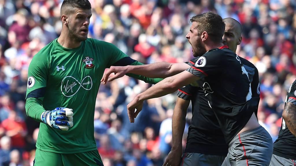 Forster celebrates saving Milner's penalty