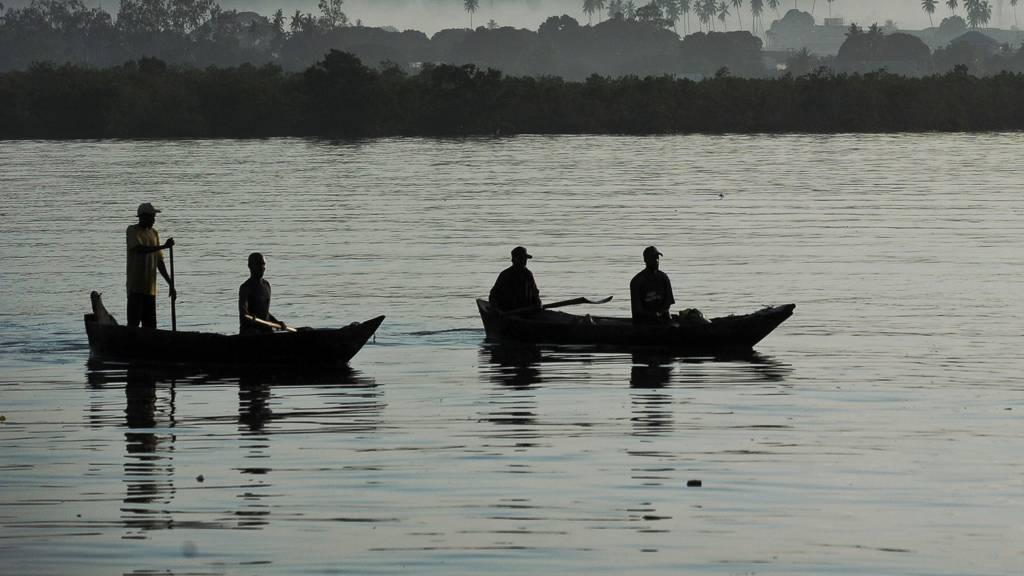Fishermen paddle to shore at dawn at Stone Town's port in Zanzibar, Tanzania - 29 October 2015