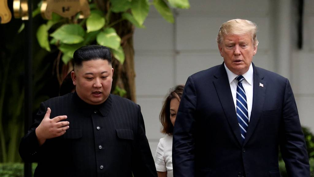 "North Korea""s leader Kim Jong Un and U.S. President Donald Trump talk in the garden of the Metropole hotel during the second North Korea-U.S. summit in Hanoi"