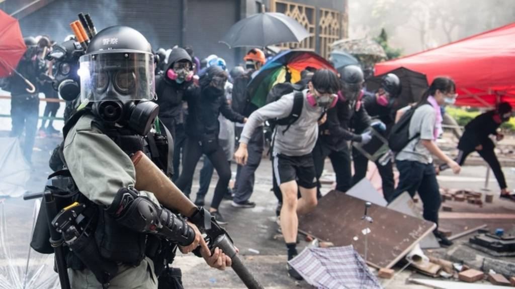 Protesters clash with armed riot police outside Hong Kong Polytechnic University