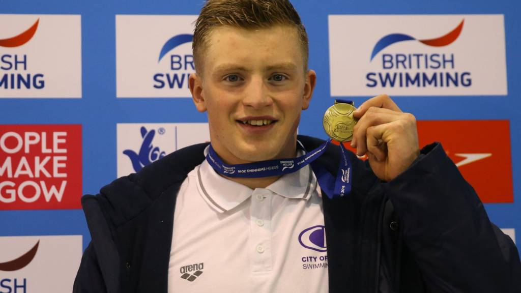 Adam Peaty with gold medal