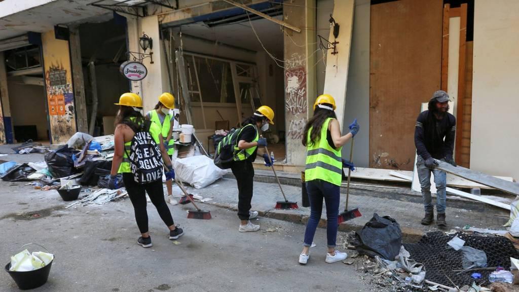 Volunteers clean debris following Tuesday's blast in Beirut's port area, Lebanon August 7, 2020