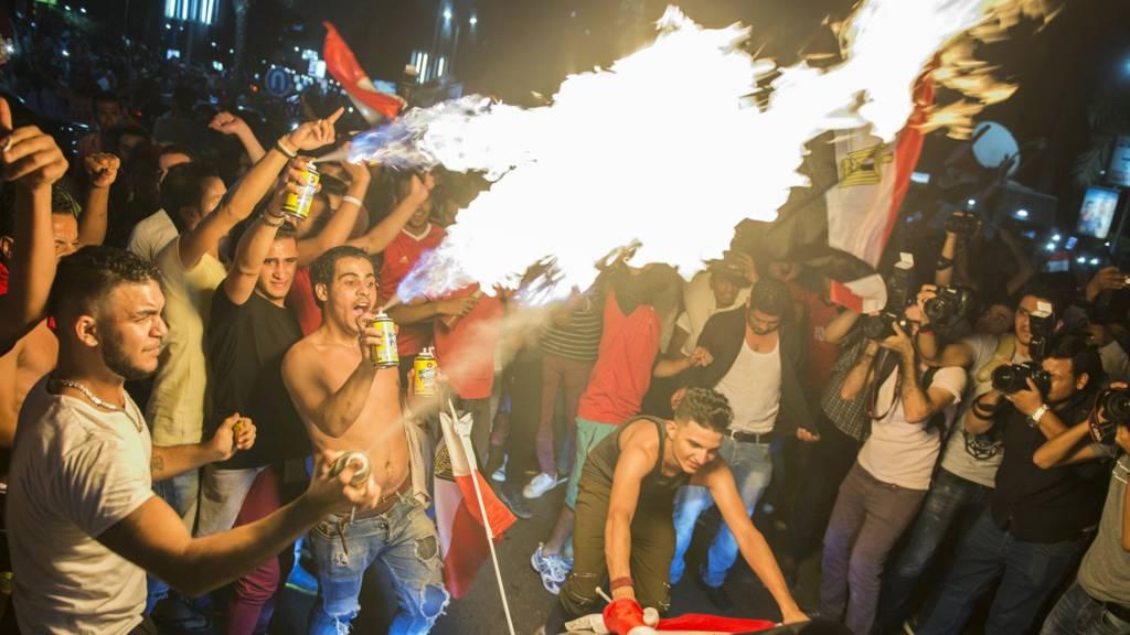 Egyptian football fans celebrating